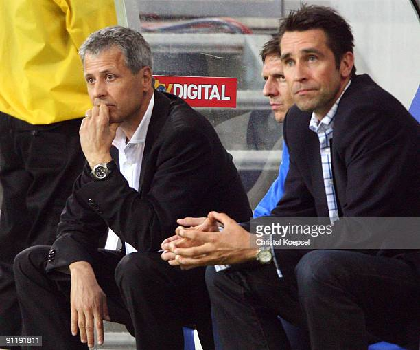 Head coach Lucien Favre of Berlin and manager Michael Preetz look dejected during the Bundesliga match between 1899 Hoffenheim and Hertha BSC Berlin...