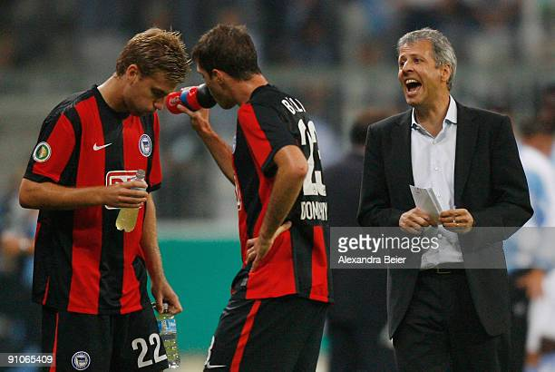 Head coach Lucien Favre of Berlin talks to his players Rasmus Bengtsson and Valeri Domovchiyski during a break at the DFB Cup second round match...