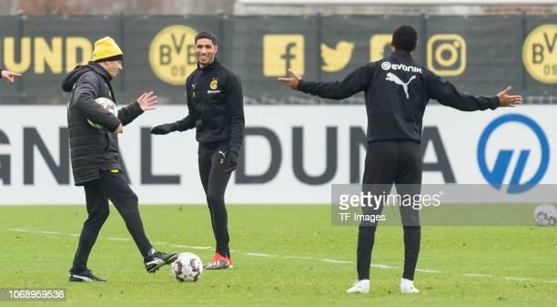 Head coach Lucien Favre of Borussia Dortmund Achraf Hakimi of Borussia Dortmund and Abdou Diallo of Borussia Dortmund during a training session at...