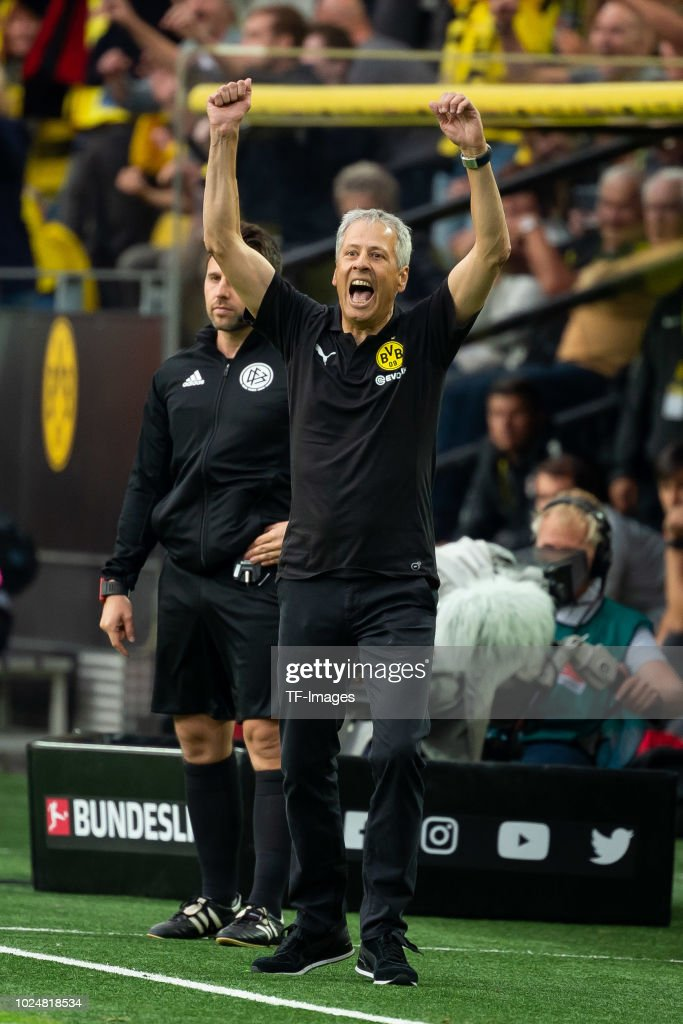 Head coach Lucien Favre of Borussia Dortmund celebrates after Marco Reus of Borussia Dortmund scored their team`s fourth goal during the Bundesliga match between Borussia Dortmund and RB Leipzig at Signal Iduna Park on August 26, 2018 in Dortmund, Germany.