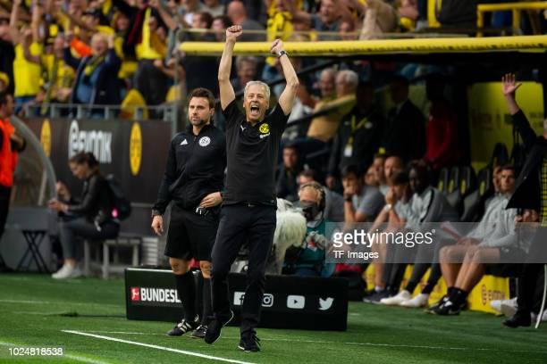 Head coach Lucien Favre of Borussia Dortmund celebrates after Marco Reus of Borussia Dortmund scored their team`s fourth goal during the Bundesliga...