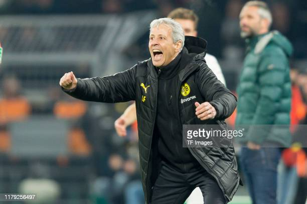 Head coach Lucien Favre of Borussia Dortmund celebrates his team's second goal during the DFB Cup second round match between Borussia Dortmund and...