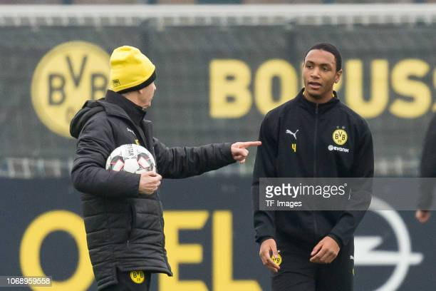 Head coach Lucien Favre of Borussia Dortmund speak with Abdou Diallo of Borussia Dortmund during a training session at BVB training center on...