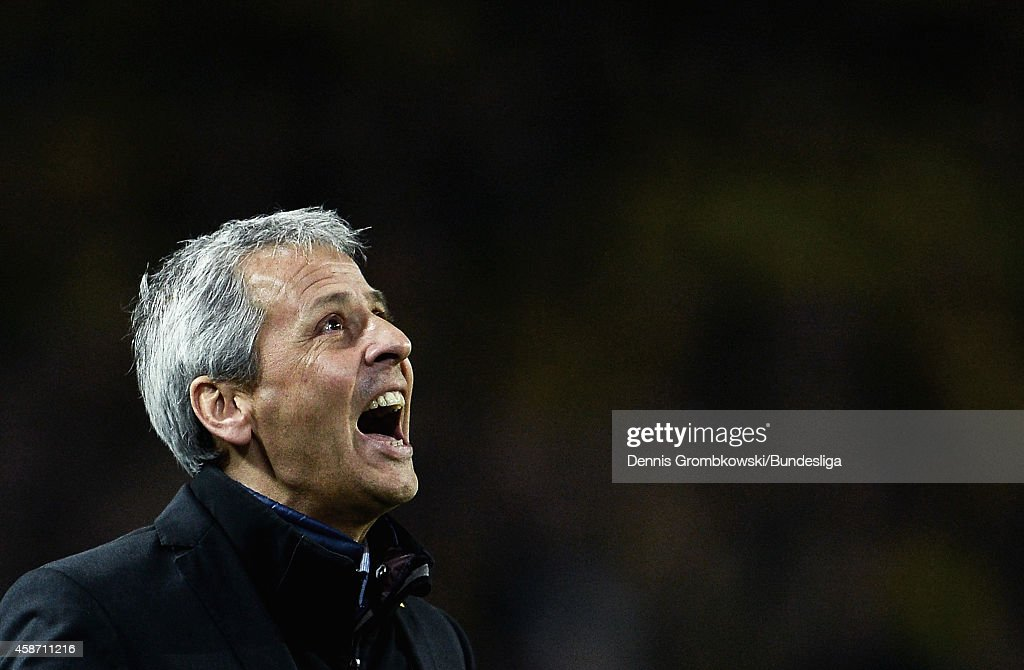 Head coach Lucien Favre of Borussia Moenchengladbach reacts during the Bundesliga match between Borussia Dortmund and Borussia Moenchengladbach at Signal Iduna Park on November 9, 2014 in Dortmund, Germany.