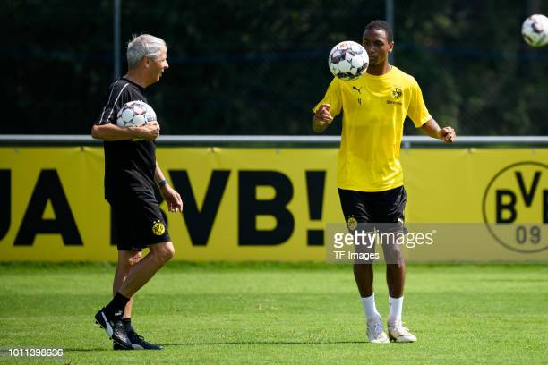 Head coach Lucien Favre of Dortmund looks on and Abdou Diallo of Dortmund controls the ball during the Borussia Dortmund training camp on August 5...
