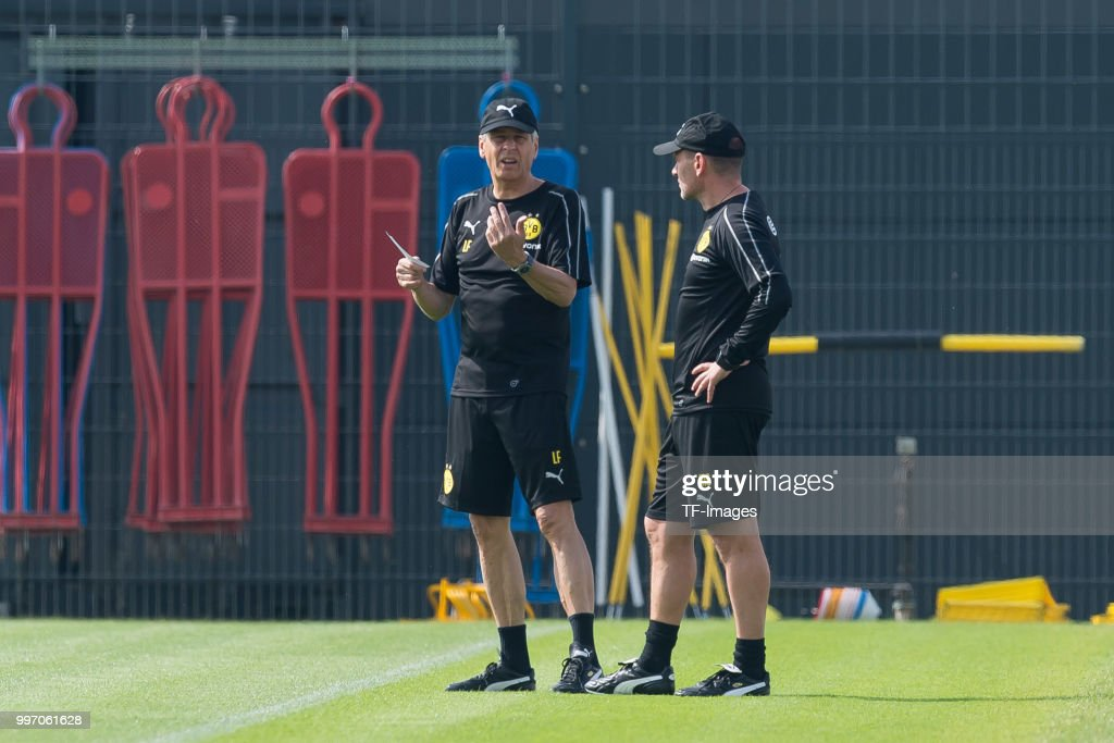 Head coach Lucien Favre of Dortmund speaks with Assistant coach Manfred Steffes of Dortmund during a training session at BVB training center on July 12, 2018 in Dortmund, Germany.