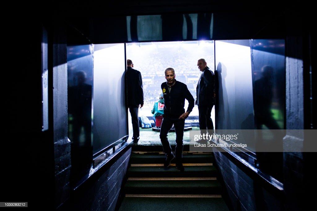 Head Coach Lucien Favre of Dortmund walks in the players tunnel prior to the Bundesliga match between Borussia Dortmund and Eintracht Frankfurt at Signal Iduna Park on September 14, 2018 in Dortmund, Germany.
