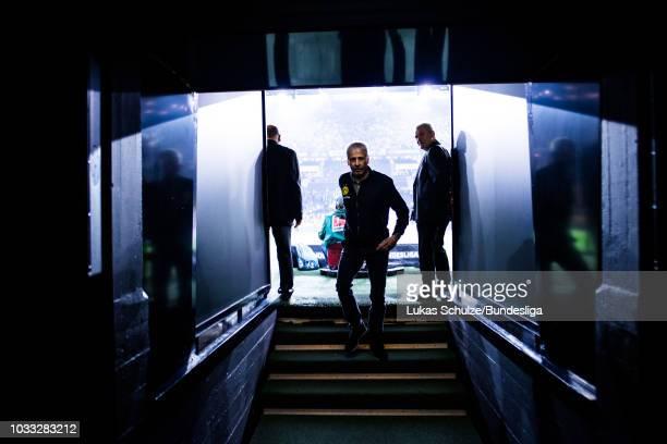Head Coach Lucien Favre of Dortmund walks in the players tunnel prior to the Bundesliga match between Borussia Dortmund and Eintracht Frankfurt at...