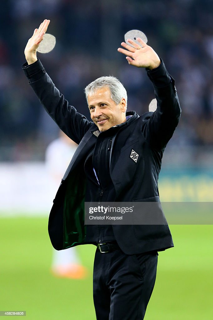 Head coach Lucien Favre of Moenchengladbach celebrates with the fans his birthday after the Bundesliga match between Borussia Moenchengladbach and 1899 Hoffenheim at Borussia Park Stadium on November 2, 2014 in Moenchengladbach, Germany. The match between Moenchengladbach and Hoffenheim ended 3-1.