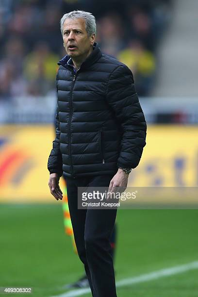 Head coach Lucien Favre of Moenchengladbach looks thoughtful during the Bundesliga match between Borussia Moenchenglkadbach and Borussia Dortmund at...