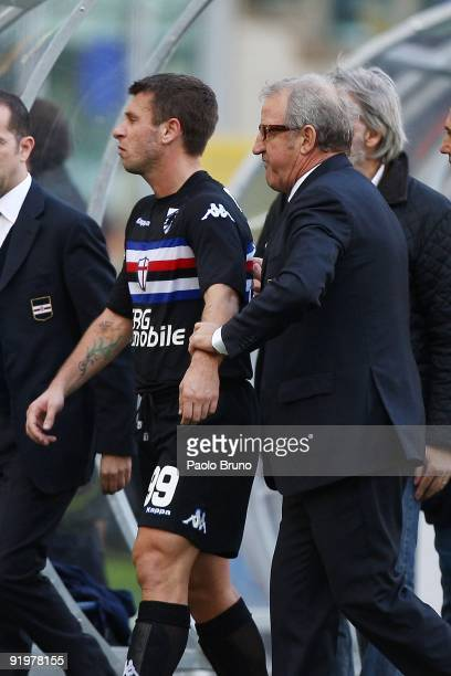 Head coach Luigi Del Neri of Sampdoria assists Antonio Cassano from the field of play after the Serie A match between SS Lazio and UC Sampdoria at...
