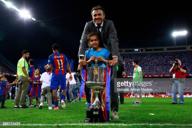 Head coach Luis Enrique Martinez of FC Barcelona poses with his daughte for a picture with the King's Cup after winning the Copa Del Rey Final...