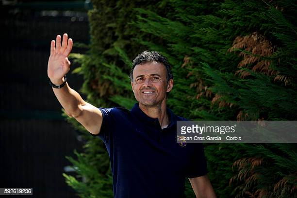 Head coach Luis Enrique of Barcelona greets the press as he arrives to attend a press conference at the Sports Center FC Barcelona Joan Gamper ahead...