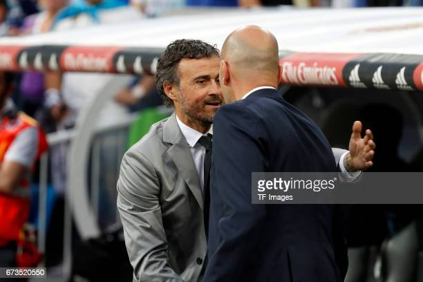 Head coach Luis Enrique of FC Barcelona shakes hands with Head coach Zinedine Zidane of Real Madrid during the La Liga match between Real Madrid CF...