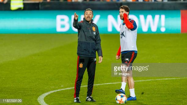 Head coach Luis Enrique of Spain and Sergio Ramos of Spain gesture during the Spain training session at Mestalla Stadium on March 22, 2019 in...