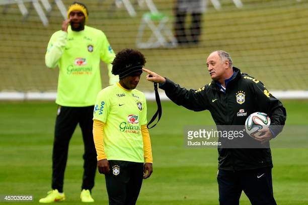 Head coach Luiz Felipe Scolari gestures with Willian during a training session of the Brazilian national football team at the squad's Granja Comary...