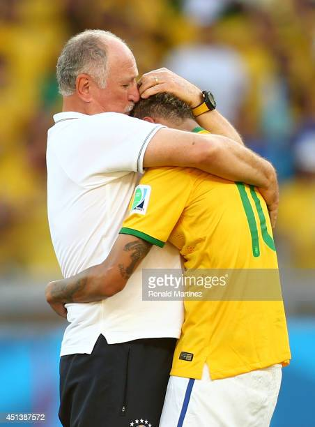 Head coach Luiz Felipe Scolari of Brazil celebrates with Neymar after defeating Chile in a penalty shootout during the 2014 FIFA World Cup Brazil...