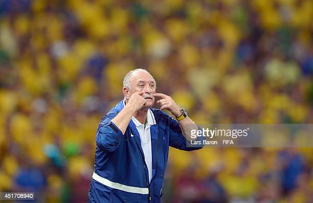 Head coach Luiz Felipe Scolari of Brazil gestures during the 2014 FIFA World Cup Brazil Quarter Final match between Brazil and Colombia at Estadio...