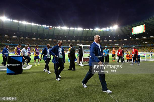 Head coach Luiz Felipe Scolari of Brazil walks off the pitch after the first half during the 2014 FIFA World Cup Brazil Semi Final match between...