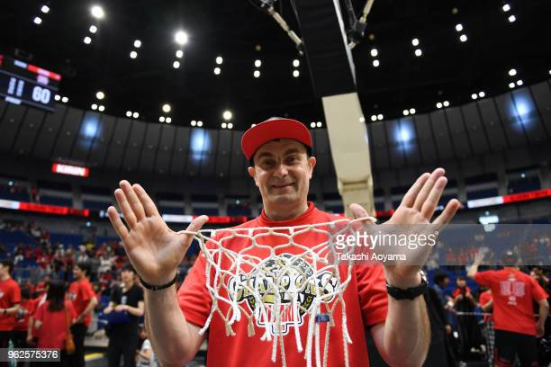 Head Coach Luka Pavicevic of the Alvark Tokyo poses for photograph with the net after defeating the Chiba Jets 85-60 in the B.League Championship...