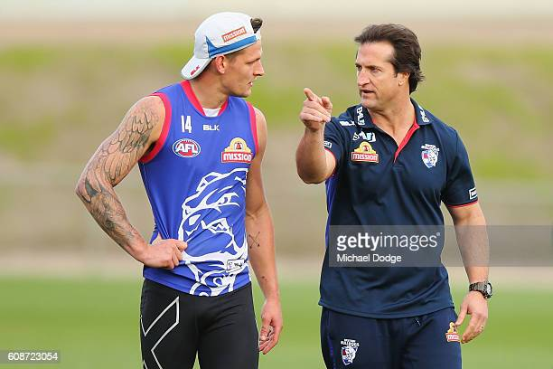 Head Coach Luke Beveridge speaks to Clay Smith during a Western Bulldogs training session at Whitten Oval on September 20 2016 in Melbourne Australia