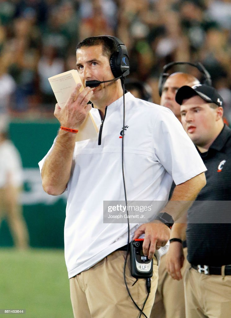 Head Coach Luke Fickell of the Cincinnati Bearcats talks on the radio during the game against the South Florida Bulls at Raymond James Stadium on October 14, 2017 in Tampa, Florida.