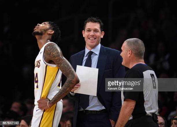 Head coach Luke Walton and Brandon Ingram of the Los Angeles Lakers reacts to referee Monty McCutchen during the first half against Houston Rockets...