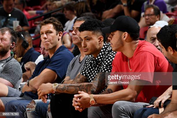 Head Coach Luke Walton General Manager Rob Pelinka Kyle Kuzma and Lonzo Ball of the the Los Angeles Lakers looks on during the 2018 Las Vegas Summer...