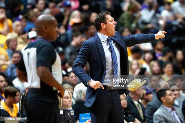 Head coach Luke Walton of the Los Angeles Lakers calls a play during the second half of a NBA preseason game against the LA Clippers at Honda Center...