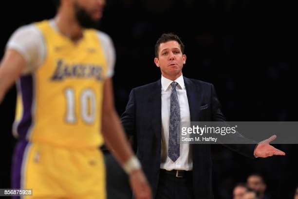 Head coach Luke Walton of the Los Angeles Lakers coaches from the bench during the first half of a preseason game against the Denver Nuggets at...