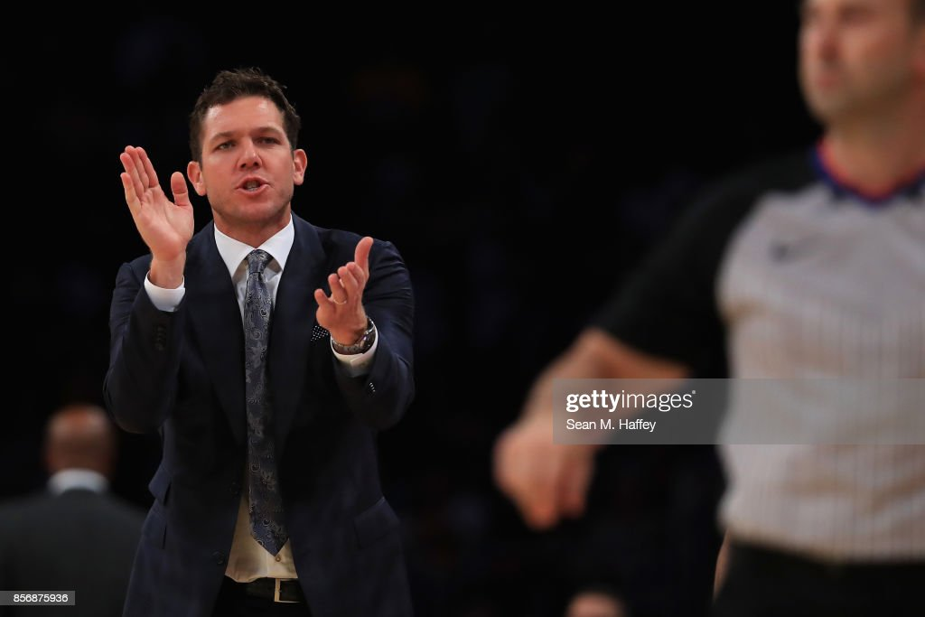 Head coach Luke Walton of the Los Angeles Lakers coaches from the bench during the first half of a preseason game against the Denver Nuggets at Staples Center on October 2, 2017 in Los Angeles, California.
