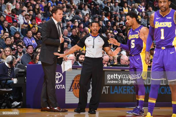 Head Coach Luke Walton of the Los Angeles Lakers referee Bill Kennedy and Josh Hart of the Los Angeles Lakers talk during the game against the...