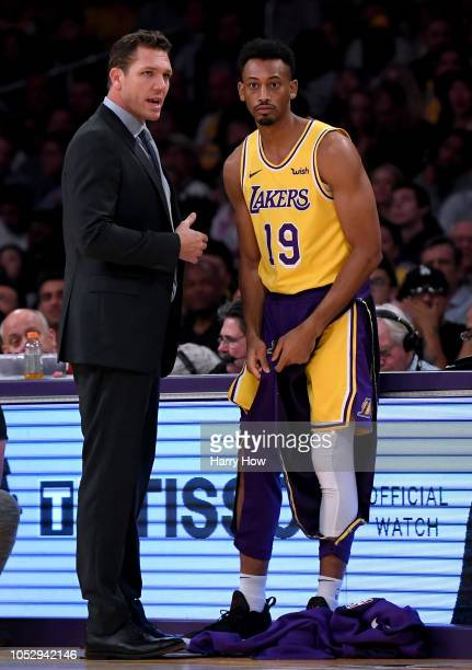 Head coach Luke Walton of the Los Angeles Lakers speaks with Johnathan Williams before entering the game against the San Antonio Spurs at Staples...