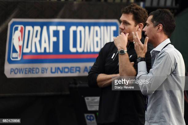 Head coach Luke Walton of the Los Angeles Lakers speaks with General Manager Rob Pelinka during Day Two of the NBA Draft Combine at Quest MultiSport...