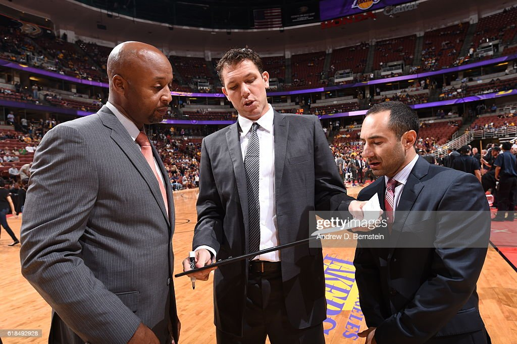 Head Coach Luke Walton of the Los Angeles Lakers speaks with his coaching staff during a preseason game against the Phoenix Suns on October 21, 2016 at Honda Center in Anaheim, California.