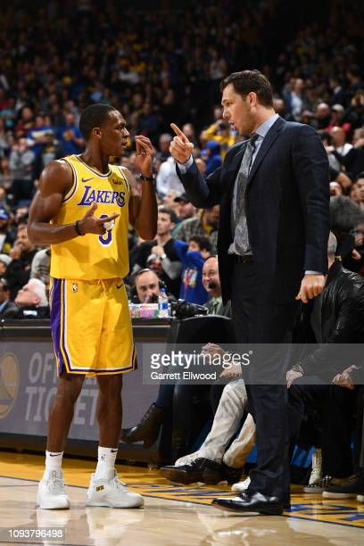 Head Coach Luke Walton of the Los Angeles Lakers speaks with Rajon Rondo during the game against the Golden State Warriors on February 2 2019 at the...