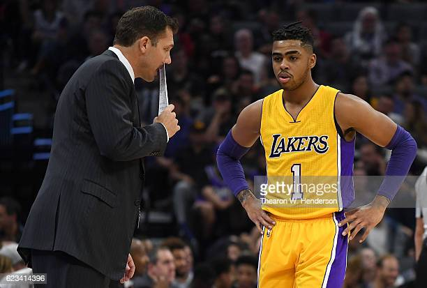 Head coach Luke Walton of the Los Angeles Lakers talks with his player D'Angelo Russell during a break in the action of an NBA basketball game...