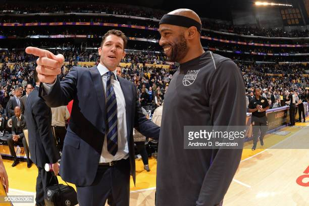 Head Coach Luke Walton of the Los Angeles Lakers talks with JaKarr Sampson of the Sacramento Kings after the game between the two teams on January 9...