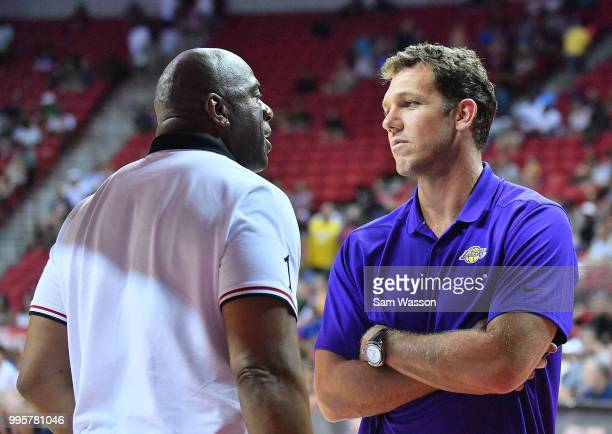 Head coach Luke Walton of the Los Angeles Lakers talks with Los Angeles Lakers president of basketball operations Earvin 'Magic' Johnson during the...