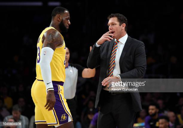 Head coach Luke Walton of the Los Angeles talks with LeBron James during a preseason basketball game against Sacramento Kingsat Staples Center on...