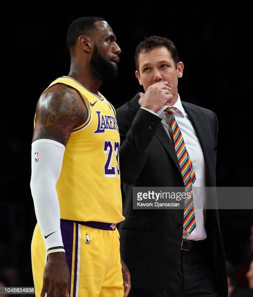Head coach Luke Walton of the Los Angeles talks with LeBron James during a preseason basketball game against Sacramento Kingsat Staples Center on...