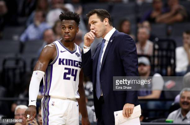 Head coach Luke Walton of the Sacramento Kings talks to Buddy Hield during their game against the Melbourne United at Golden 1 Center on October 16,...