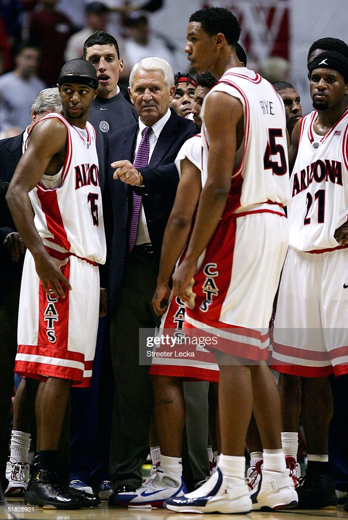 Head coach Lute Olson of the Arizona Wildcats looks on with his team during their game against the Mississippi State Bulldogs on December 5, 2004 at The Arrowhead Pond in Anaheim, California.