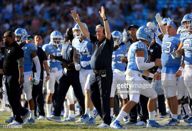 Head coach Mack Brown of the North Carolina Tar Heels reacts after his team scores against the South Carolina Gamecocks during the Belk College...