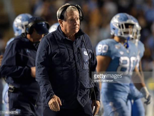 Head coach Mack Brown of the North Carolina Tar Heels watches him play against the Virginia Cavaliers during the second half of their game at Kenan...
