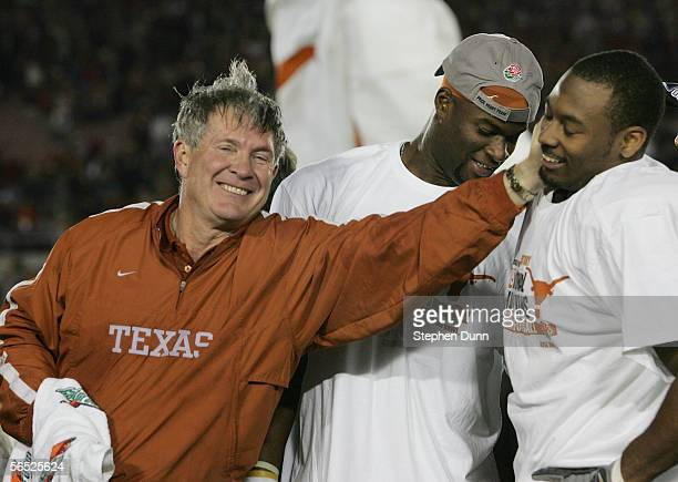 Head coach Mack Brown of the Texas Longhorns celebrates with Michael Huff and Vince Young after defeating the USC Trojans 4138 to win the BCS...