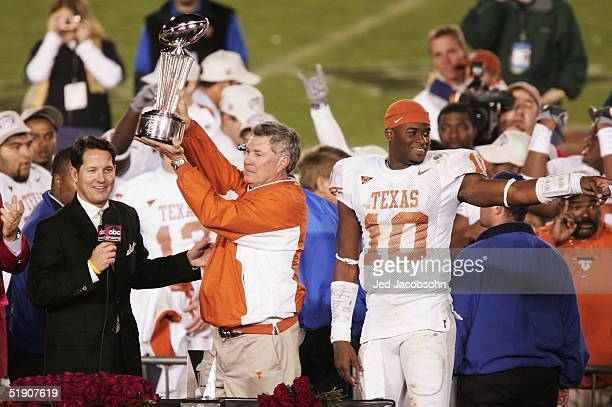 Head coach Mack Brown of the Texas Longhorns celebrates with the trophy after defeating the Michigan Wolverines in the 91st Rose Bowl Game at the...