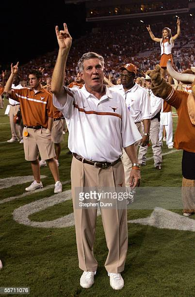Head coach Mack Brown of the Texas Longhorns gives the 'Hook'em Horns' sign as the Texas band plays the traditional 'Eyes of Texas' after their game...
