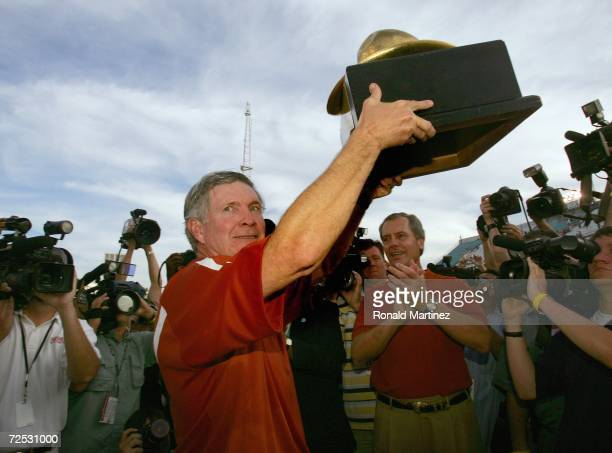 Head coach Mack Brown of the Texas Longhorns lifts the 'Golden Hat' the traditional Red River Shootout trophy after winning against the Oklahoma...