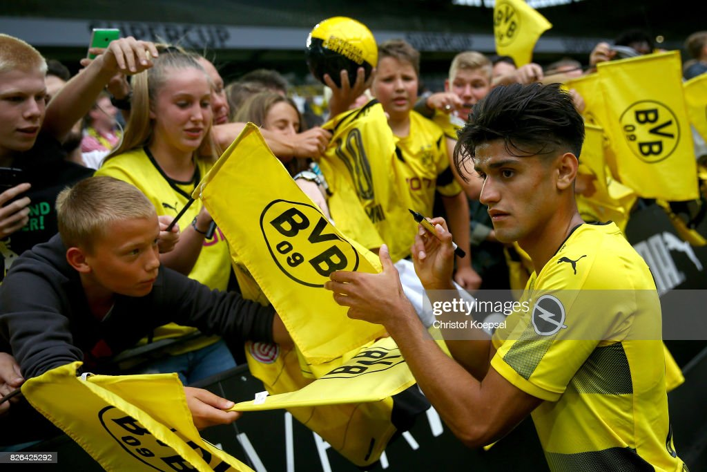 Head coach Mahmoud Dahoud gives autographs during the Borussia Dortmund Season Opening 2017/18 at Signal Iduna Park on August 4, 2017 in Dortmund, Germany.